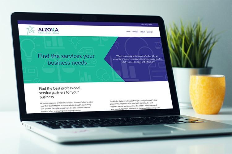 Laptop displaying old Alzoka website design