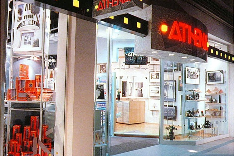 Shopfront design with a projecting sign showing the Athena branding