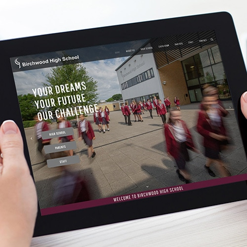 A person viewing Birchwood High School website on tablet thumbnail
