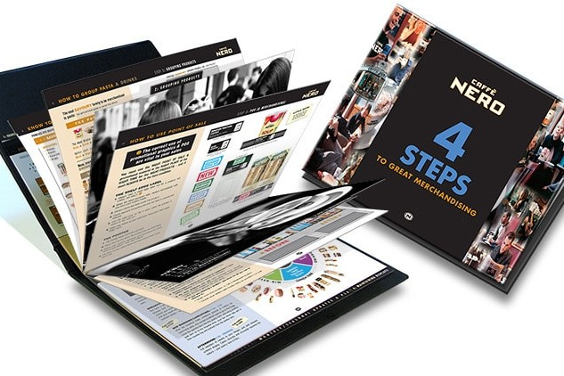 Caffè Nero Visual Merchandising Manual print design showing front cover and open spread