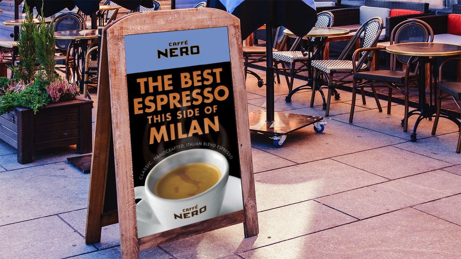 Signage with Caffè Nero promotion showing a digitally retouched map of Italy swirling in the froth of the Espresso in the cup