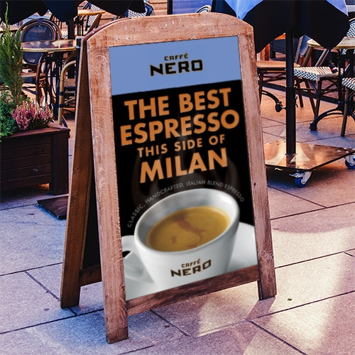 Signage with Caffe Nero promotion showing a digitally retouched map of Italy swirling in the froth of the Espresso in the cup Thumbnail