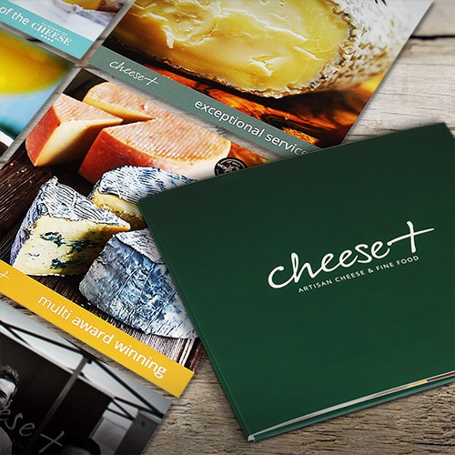 Front cover and spread of Cheese Plus corporate folder showing full-bleed images of cheese