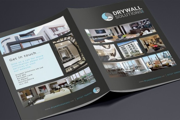 Opened Drywall Solutions black brochure showing the Front and back print design