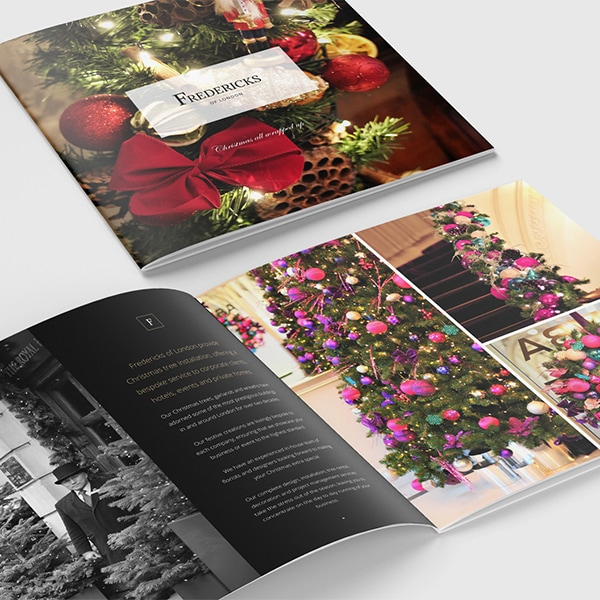 Christmas brochure print design with decorated Christmas tree front cover and spread for Fredericks of London