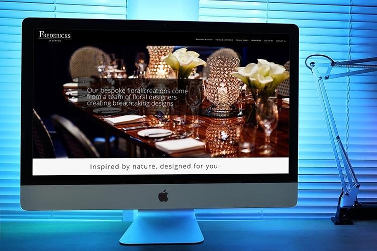 Fredericks of London Homepage Website Design Desktop with blue lit background