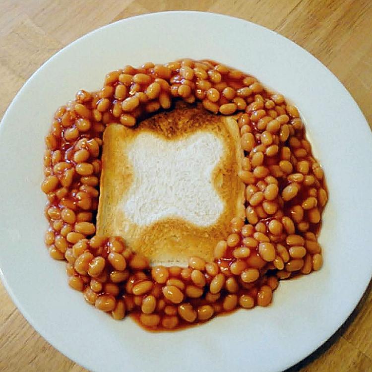 Beans on toast breakfast with GEO symbol on toasted bread slice