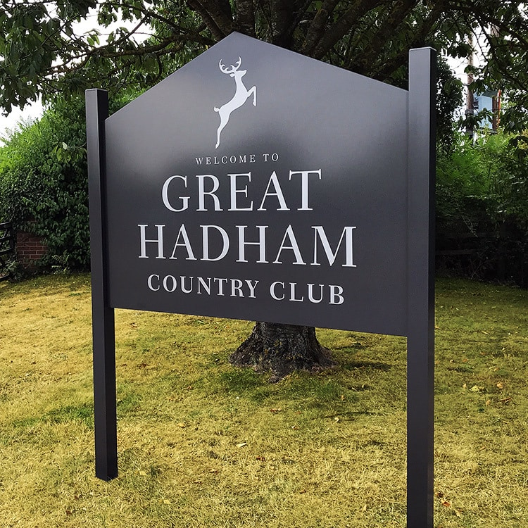 Welcome to Great Hadham Country Club with stag logo on Black sign