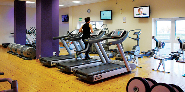 Person jogging on Treadmill at Great Hadham Country Club gym