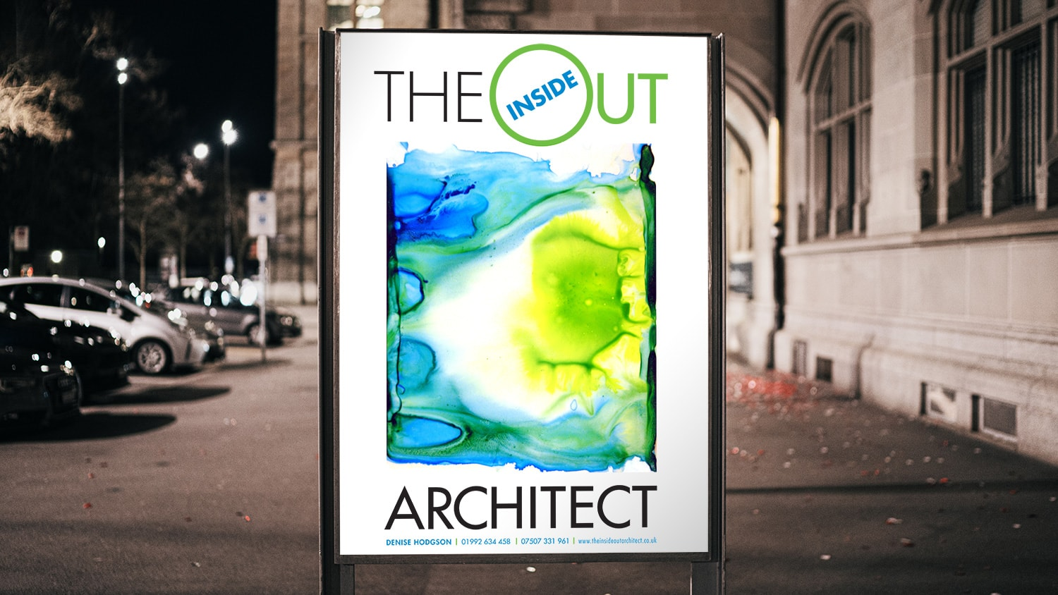 Illuminated poster design for Inside Out Architect outside a building