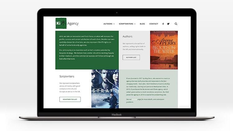 Laptop displaying home page of Ki Agency responsive website design