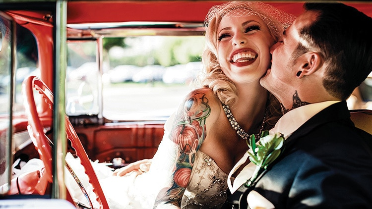 Newlywed Man and woman in car smiling photography for Kodak Alaris