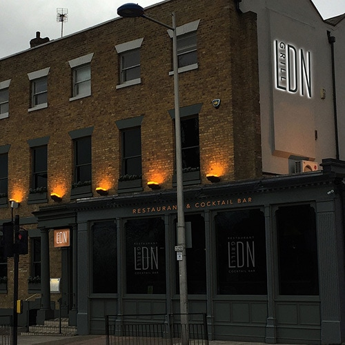 LDN grill exterior branding with an illuminated sign and projecting sign Thumbnail