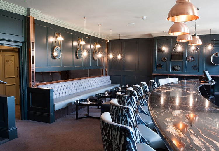LDN Grill bar with marble table and textured stools photography
