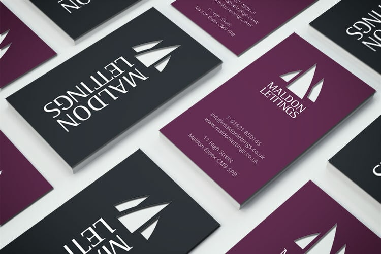 Business cards with Maldon Lettings symbol cut-outs for Maldon Lettings branding design corporate stationery