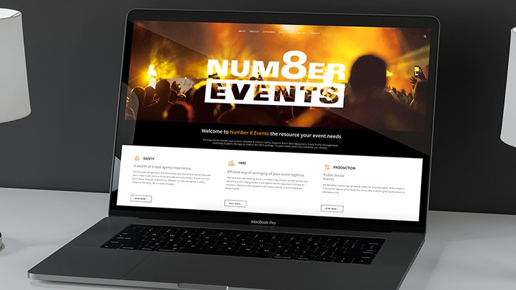 Laptop displaying the homepage of Number 8 Events website design