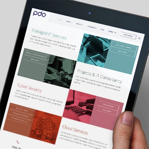 A person holding a tablet viewing the new responsive website design for PDQ Thumbnail