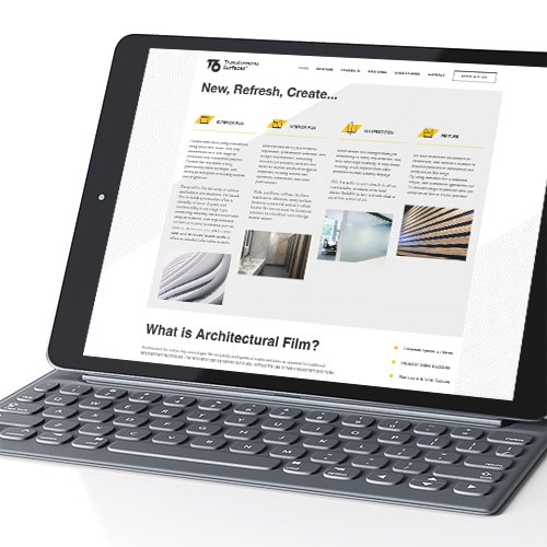 Tablet with keyboard display homepage of T6 responsive website design Thumbnail