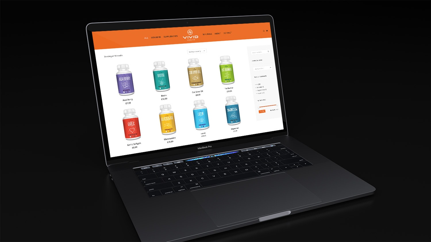Laptop in a dark room displaying the Vivid Health responsive eCommerce shop page website