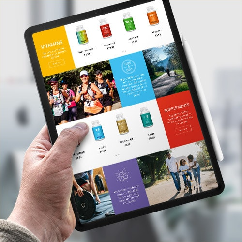 A person holding a tablet displaying the Vivid Health responsive eCommerce shop page website