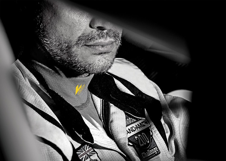 Close up of man in a racecar wearing Walero branded garment