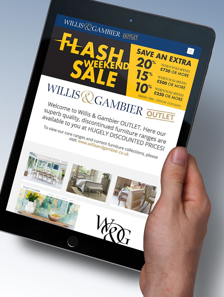A person holding an iPad with a flash sale weekend banner