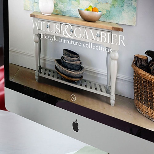Close up of desktop displaying the Willis & Gambier website with a full bleed image of Willis & Gambier furniture Thumbnail