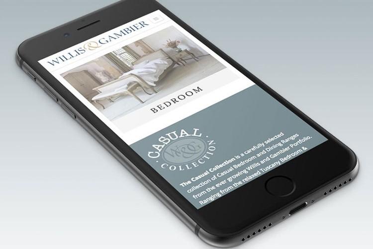 Mobile displaying the responsive Willis & Gambier website design