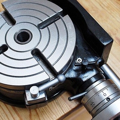Retouched and enhanced close up of a lathe machine tilting rotary table for Tilgear