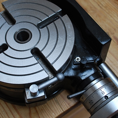 Original close up of a lathe machine tilting rotary table for Tilgear