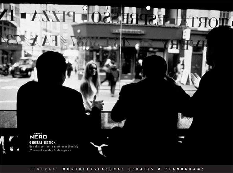 Black and white image of a people sitting on the table looking through the window for Caffè Nero manual dividers