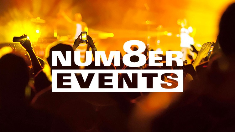 People enjoying a concert with Number 8 Events branding design