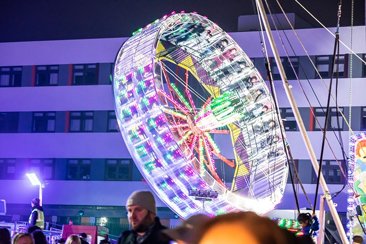Illuminated spinning carnival ride with people photography for Number 8 Events