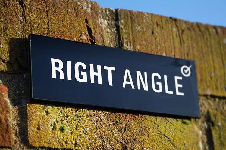 Close up of Right Angle Signage on bricks