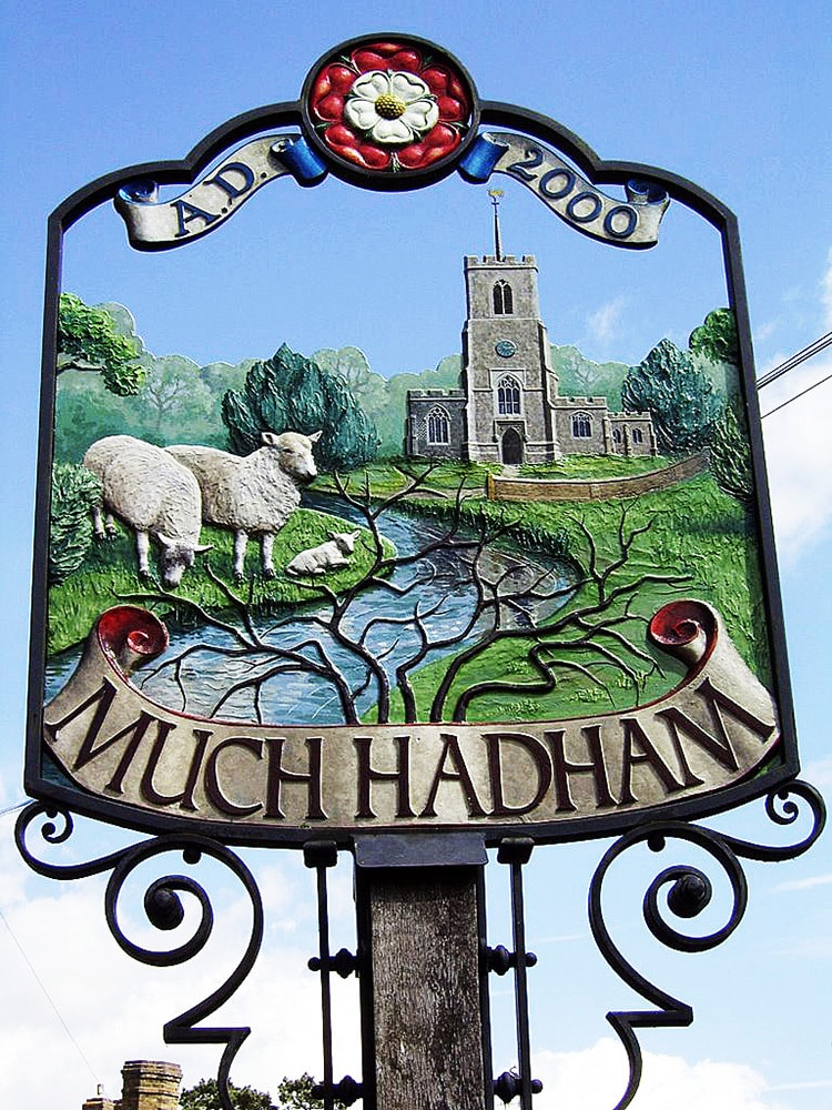 Local Much Hadham sign with sheeps and a castle