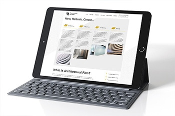 Tablet with keyboard display homepage of T6 responsive website design