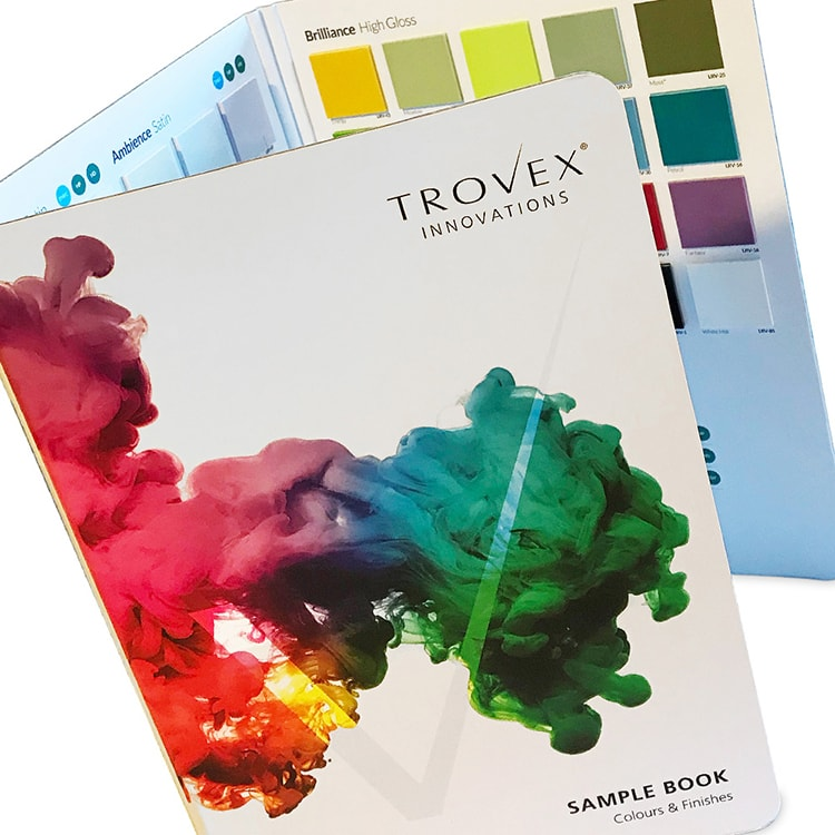 Close up of Trovex Innovations Sample Book with coloured ink splash on front